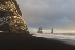 Amazing nature of Iceland. Black sand. The black sand beach of Reynisfjara and the mount Reynisfjall from the Dyrholaey promontory in the southern coast of royalty free stock photography