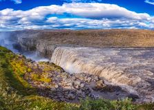 Amazing nature landscape, stunning Dettifoss waterfall with rocky canyon and blue cloudy sky Iceland. Scenic panoramic aerial view. Outdoor travel background royalty free stock photos