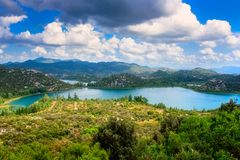 Amazing nature, scenic summer landscape with emerald lakes, mountains and blue cloudy sky, Bacina Lakes Bacinska jezera, Croatia. Outdoor travel background royalty free stock photo