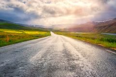 Amazing nature, sunny landscape with scenic empty asphalt road and cloudy sky. Hringvegur, the main ring road in Iceland, travel outdoor summer background royalty free stock images