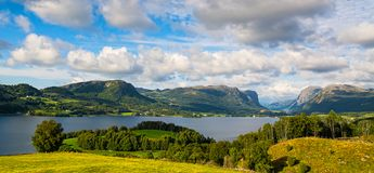 Amazing nature view with fjord, mountains and fields. Beautiful royalty free stock images