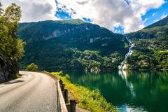 Amazing nature view with fjord, waterfall and mountains. Beautif royalty free stock images