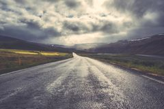 Amazing nature, vintage landscape with scenic empty asphalt road and cloudy sky. Hringvegur, the main ring road in Iceland, travel outdoor summer background stock photography