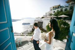 Amazing newlyweds in hotel on sea shore Stock Photos