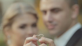 Amazing newlyweds show their wedding gold rings stock video footage