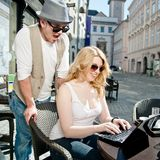 Amazing News. Couple are amazed about something in the laptop Royalty Free Stock Photos