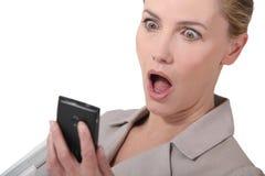 Amazing news on phone Stock Images