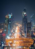 Amazing night dubai downtown skyline and road leading to Abu Dhabi, Dubai, United Arab Emirates. Amazing night dubai downtown skyline with tallest skyscrapers stock photography