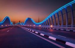Amazing night dubai VIP bridge. Private road to Meydan race course, Dubai, United Arab Emirates. Amazing night dubai VIP bridge with beautiful sunset. Private royalty free stock photo