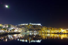 Amazing night photo of Kavala and moon over old town, Greece. Amazing night photo of Kavala and moon over old town,  East Macedonia and Thrace, Greece Royalty Free Stock Photography