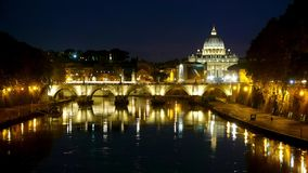 Amazing night shot of Tiber River and its bridges in Rome - with a view over Vatican stock footage