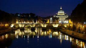 Amazing night shot of Tiber River and its bridges in Rome - with a view over Vatican stock video footage