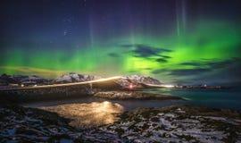 Amazing night sky with Aurora Borealis over Atlantic Ocean Road in Norway stock photo