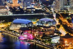Amazing night view of downtown in Singapore. Amazing night view of old and modern buildings at downtown of Singapore. Colorful city lights reflected in water of royalty free stock photo