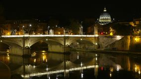 Amazing night view over the Bridges of Rome and St Peters Basilica stock video
