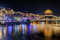 Amazing night view of Phoenix Ancient Town (Fenghuang County royalty free stock photos