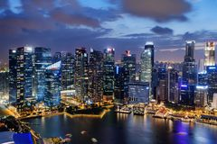 Amazing night view of skyscrapers at downtown of Singapore. Colorful city lights reflected in water of Marina Bay. Beautiful cityscape. Singapore is a popular stock photos