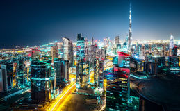 Amazing nighttime skyline: skyscrapers of a big modern city. View of Dubai business bay. Royalty Free Stock Photos