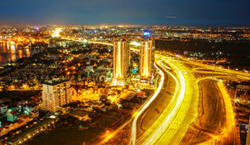 Amazing nightscape of Ho chi Minh city, Vietnam. From high view, city bright in yellow electric light, trail on road, landscape of new urban in radiant colors Stock Image