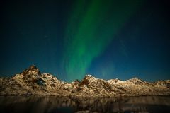 Free Amazing Northern Lights, Aurora Borealis Over The Mountains In The North Of Europe - Lofoten Islands, Norway Royalty Free Stock Images - 163808849