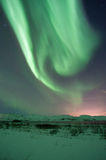 The amazing northern lights over the landscape in winter Iceland. Stock Photo