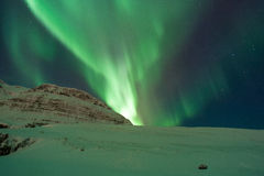 The amazing northern lights over the landscape in winter Iceland. Royalty Free Stock Photos