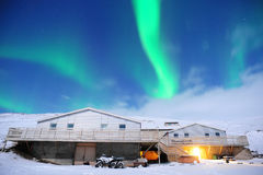The amazing northern lights over the silo in winter Iceland. Royalty Free Stock Images