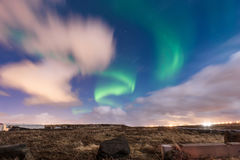 The amazing northern lights over the vast field in winter Iceland. Royalty Free Stock Images