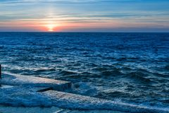 Amazing Ocean sunset at the Pier in calm weather. Nature. Amazing Ocean sunset at the Pier in calm weather Stock Photo