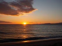 Amazing orange sunset on a beautiful empty beach stock photo