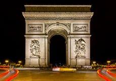 Arc de triomphe in Paris at dark night. Amazing ornamental monument of Arc de Triomphe illuminated at dark night in Paris Royalty Free Stock Photo