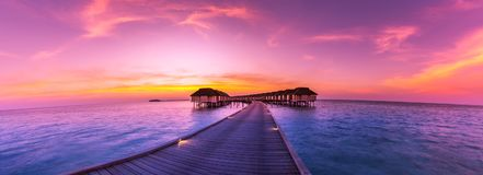 Amazing panorama beach landscape. Maldives sunset seascape view. Horizon with sea and sky. Tranquil scenery, tourism and travel royalty free stock photography
