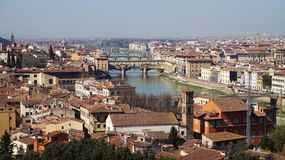 Amazing panorama of Florence with Ponte Vecchio bridge in the middle of picture, in a sunny day, Florence, Italy.  Stock Photography