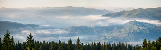Amazing panorama of foggy mountain range royalty free stock photography
