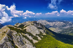Amazing panorama green mountains and blue sky in Montenegro. Mou. The amazing panorama green mountains and blue sky in Montenegro. Europe, Montenegro Stock Images