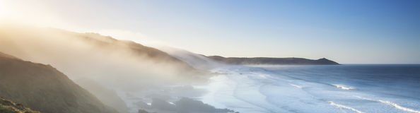Amazing panorama of headland and sea fog at sunrise. Royalty Free Stock Photography