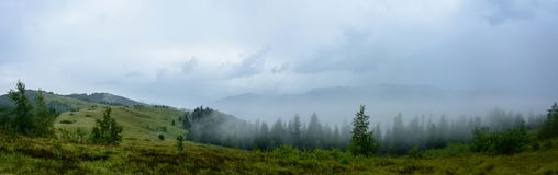 Amazing panorama on the mountain Yavorinka in the Carpathians during the rain stock image