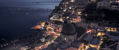 Amazing panorama of Positano town by night, Italy royalty free stock photography