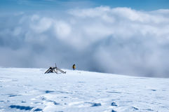 Amazing panorama sunny winter landscape with snowstorm and hiker Stock Photo