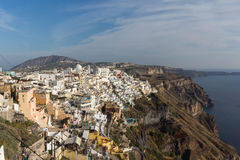 Amazing panorama to town of Fira and Prophet Elias peak, Santorini island, Thira, Greece Royalty Free Stock Images