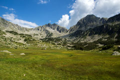 Amazing panorama of The Tooth and Yalovarnika peaks in Pirin Mountain Royalty Free Stock Photo