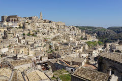 Amazing panorama view of ancient ghost town of Matera Sassi di. Matera in bright sun shine summer with blue sky, south Italy Royalty Free Stock Photography