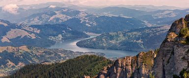Amazing Panorama view in Ceahlau mountains in Romania. Amazing beautiful view in Ceahlau peak mountains in Romania Royalty Free Stock Images