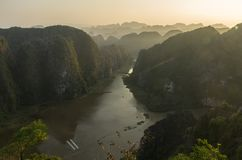 Amazing panorama view of limestone rocks and mountaintops from Hang Mua Temple at evening. Ninh Binh, Vietnam. Travel landscapes stock photography