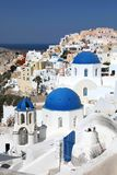 Amazing panorama view with white houses and blue domes in Oia village on Santorini island, Greece stock image