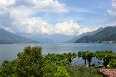 Amazing panorama with white clouds of Bellagio town on Lake Como, Italy Royalty Free Stock Image