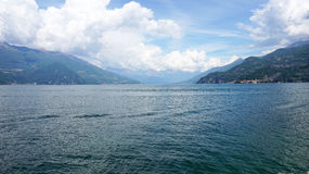 Amazing panorama with white clouds of Bellagio town on Lake Como, Italy Stock Images