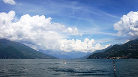 Amazing panorama with white clouds of Bellagio town on Lake Como, Italy Royalty Free Stock Images