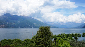 Amazing panorama with white clouds of Bellagio town on Lake Como, Italy Stock Photos