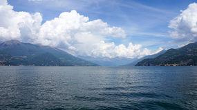 Amazing panorama with white clouds of Bellagio town on Lake Como, Italy. Stock Image